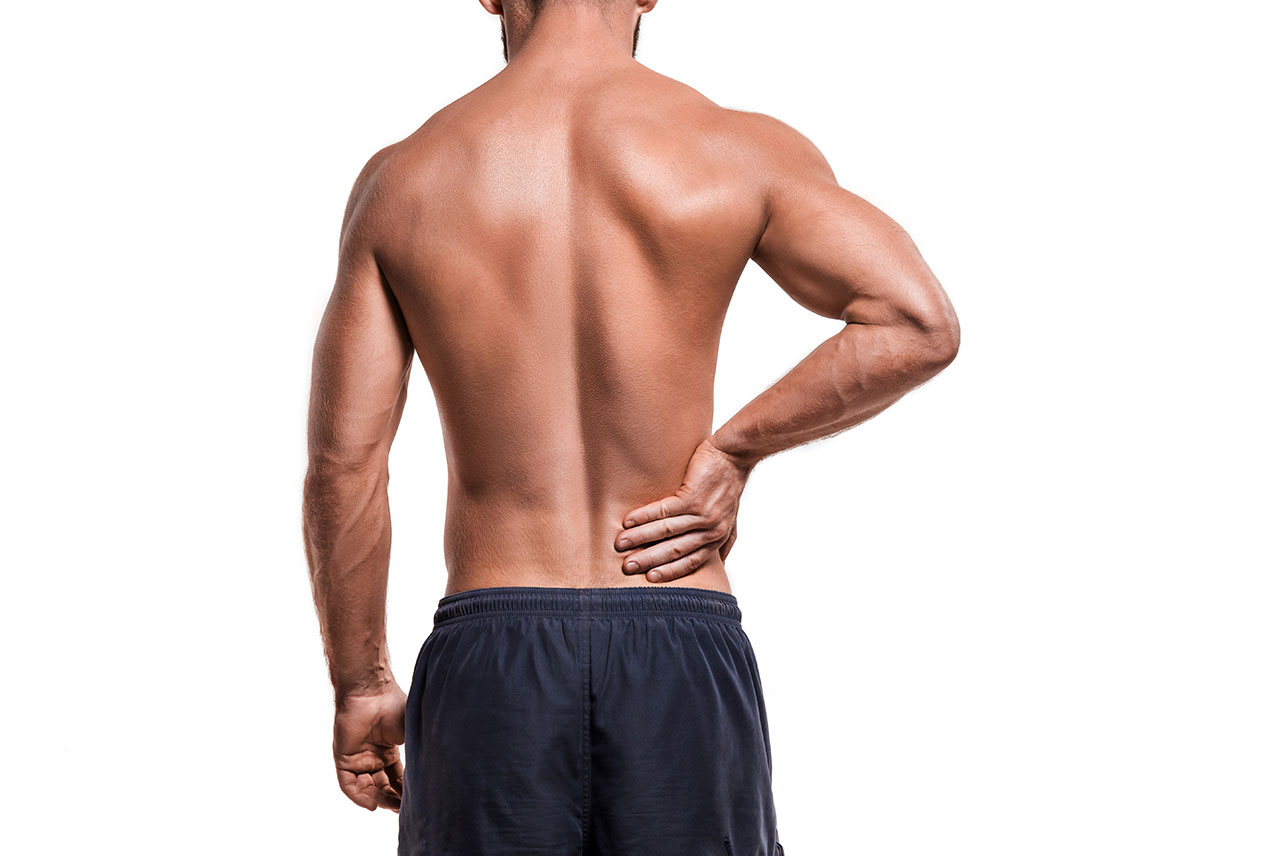 Shirtless man with back pain