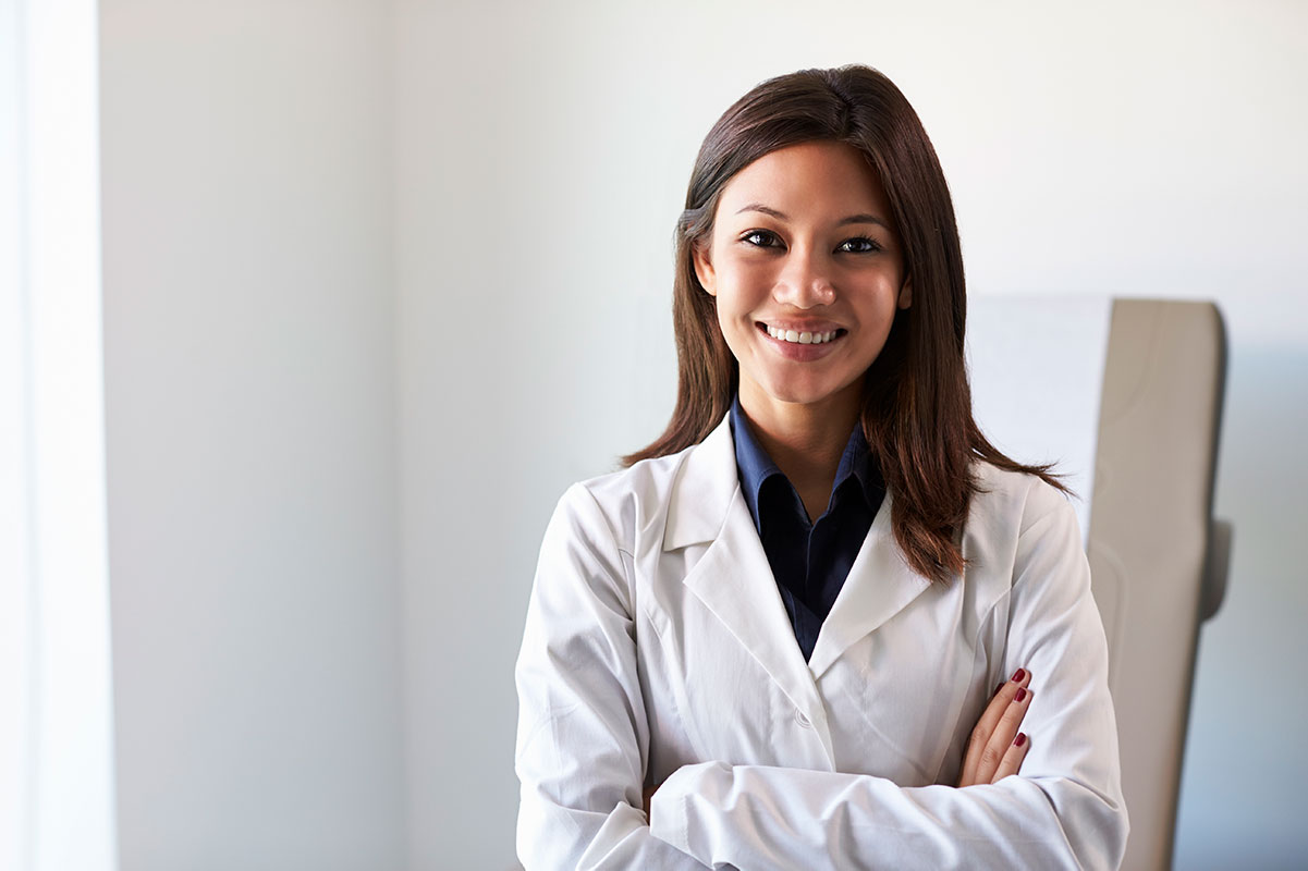 portrait of female doctor wearing white coat in PRAN3NV